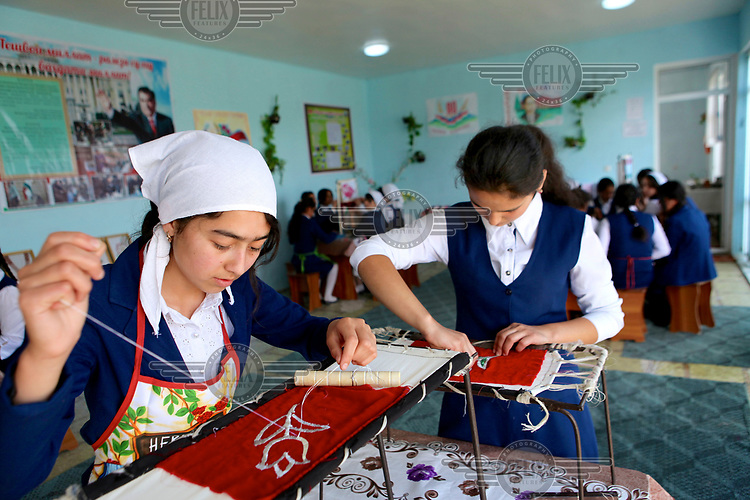 Girls learning embroidery at a school in Khistevarz where youths aged 15 and 16 learn practical life skills.