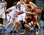 SIOUX FALLS MARCH 22:  Taylor Parmley #14 of Grand Valley State reaches on Mikaela Burgess #15 of Pittsburg State during their quarterfinal game at the NCAA Women's Division II Elite 8 Tournament at the Sanford Pentagon in Sioux Falls, S.D. (Photo by Dick Carlson/Inertia)