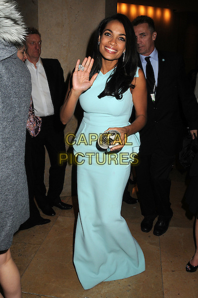 Rosario Dawson.70th Annual Golden Globes - Post Show Exits held at the Beverly Hilton Hotel, Beverly Hills, California, USA..January 13th, 2013.globes full length blue sleeveless peplum dress hand arm waving silver clutch bag.CAP/ADM/BP.©Byron Purvis/AdMedia/Capital Pictures.