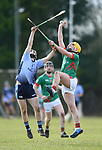 Fionn Slattery of Scariff Community College in action against Evan Hawkes of St Fergal's College during their All-Ireland Colleges final at Toomevara. Photograph by John Kelly.