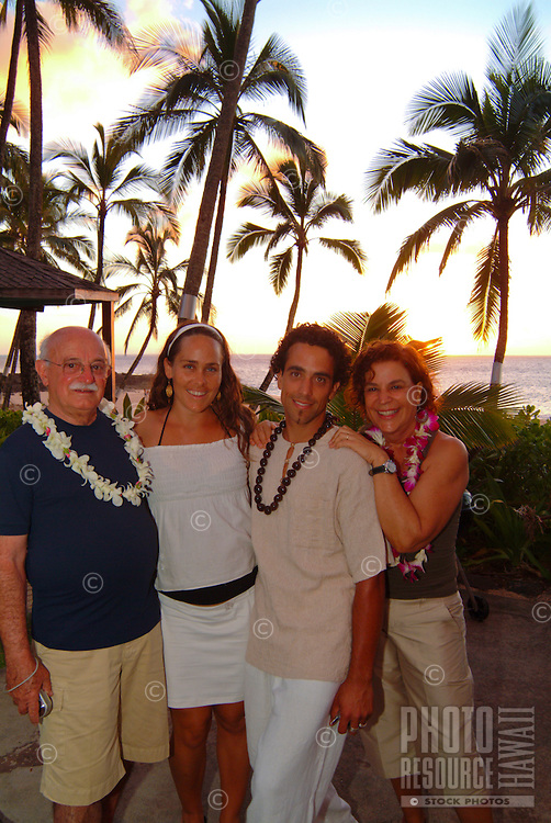 A young local couple with parents at Ke'iki Beach, North Shore