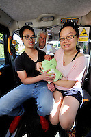 VIDEO AVAILABLE<br /> Pictured: Kai Huang and his partner Qiuxia Chen who gave birth to their son Loeoin the back of a Swansea taxi cab, pictured with cabby Steve Storton. Baby Loeo was born at 6.45 on Sunday evening  in Sketty, Swansea on their way to hospital.<br /> Re: When taxi driver Stephen Storton embarked on his evening shift, he didn't expect one of his customers to give birth in the back of his car.<br /> But that is exactly what happened when the Data Cabs driver picked up Chinese pair Kai Huang and Quix India.<br /> He said he had never seen anything like it after years working as a taxi driver.<br /> &quot;It came up on the computer that there was a taxi booked in Townhill for 6.30pm so off I went.<br /> &quot;When I got there a guy came out and said that his wife was in labor.<br /> &quot;When I was driving to the hospital she screamed that the baby was coming and that she could feel the head.<br /> &quot;I then pulled over by the side of Vivian Road in Sketty and the baby was born at 6.45pm.&quot;<br /> The baby's father Kai Huang described the moment he &quot;freaked out&quot; when his wife Quixia Chen gave birth to their son He said: &quot;I was really scary, I freaked out.<br /> &quot;My wife started experiencing some painful contractions so we phoned the hospital and they told us to get her to the hospital immediately.<br /> &quot;We then phoned a taxi and it arrived within five minutes.<br /> &quot;The baby came really quickly and half way to the hospital the driver had to pull over as the baby was born before the ambulance arrived.<br /> &quot;Both mother and baby are healthy now and the baby is called Loeo.&quot;