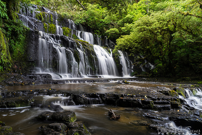 The Purakaunui Falls are a cascading three-tiered waterfall on the Purakaunui River in The Catlins region of the South Island of New Zealand.