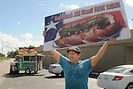 Mario Morales tries to bring in traffic to his Yummy Dog food truck on Durham Thursday Oct 09, 2014.(Dave Rossman photo)