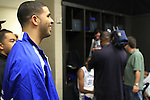 Rap artist Drake waits in the locker room to talk to the UK men's basketball team after their 90-60 win over Wake Forest for the second round of the NCAA tournament at New Orleans Arena on Saturday, March 20, 2010. Photo by Adam Wolffbrandt | Staff