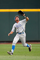UCLA outfielder Brian Carroll (24) makes a catch during Game 1 of the 2013 Men's College World Series Finals against the Mississippi State Bulldogs on June 24, 2013 at TD Ameritrade Park in Omaha, Nebraska. The Bruins defeated the Bulldogs 3-1, taking a 1-0 lead in the best of 3 series. (Andrew Woolley/Four Seam Images)