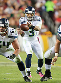 Seattle Seahawks quarterback Russell Wilson (3) takes a snap during second quarter action against the Washington Redskins at FedEx Field in Landover, Maryland on Monday, October 6, 2014.<br /> Credit: Ron Sachs / CNP