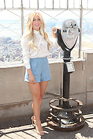 """NEW YORK, NY - JULY 11: Julianne Hough and Bear Grylls visit the Empire State Building in celebration of the season premiere of """"Runing Wild with Bear Grylls"""" on July 11, 2016 in New York City. Credit: DC/Media Punch"""