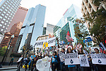 Powershift March passes in front of the PNG building in Pittsburgh. Over six thousand young people from all over the country are converging in Pittsburgh, PA for Power Shift 2013, a massive training dedicated to bringing about a safe planet and a just future for all people. (Photo by: Robert van Waarden)