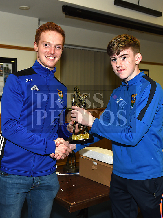 James Sands is presented with the under 13 Player of the Year award by Donal McKenny at the St. Mary's juvenile awards night. Photo:Colin Bell/pressphotos.ie