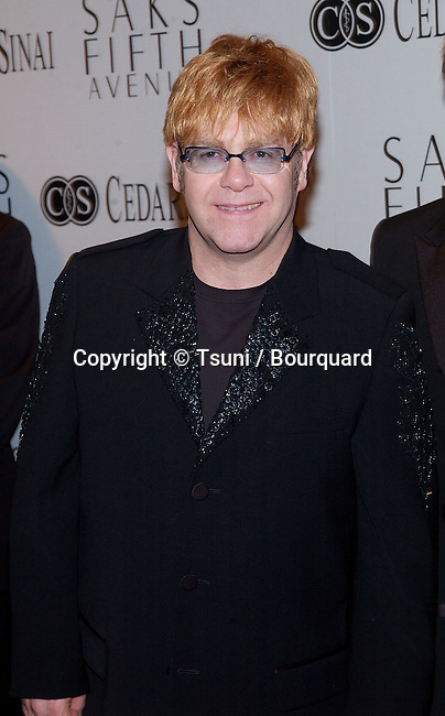 Elton Jones arriving at the benefit for the Cedars Sinai research for Women's Cancer at the Regent Beverly Wilshire in Los Angeles. March 26, 2002.             -            JohnElton_sir_01.jpg