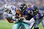 Dallas Cowboys tight end Gavin Escobar (89), Baltimore Ravens inside linebacker C.J. Mosley (57) and Baltimore Ravens free safety Matt Elam (26) in action during the pre-season game between the Baltimore Ravens and the Dallas Cowboys at the AT & T stadium in Arlington, Texas. The Ravens lead Dallas 24 to 10 at half time.