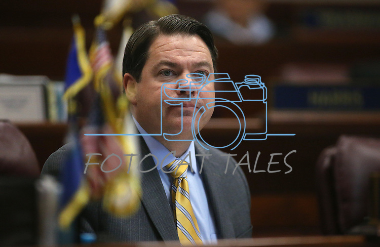Nevada Senate Majority Leader Michael Roberson, R-Henderson, works on the Senate floor at the Legislative Building in Carson City, Nev., on Wednesday, Dec. 16, 2015. Gov. Brian Sandoval called lawmakers into a special session Wednesday to consider a package of tax incentives to bring the startup electric car manufacturer Faraday Future to Southern Nevada. (Cathleen Allison/Las Vegas Review-Journal)
