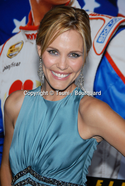 Leslie Bibb arriving at the Talladega Nights Premiere at the Chinese Theatre In Los Angeles. July 26, 2006.<br /> <br /> eye contact<br /> headshot<br /> smile