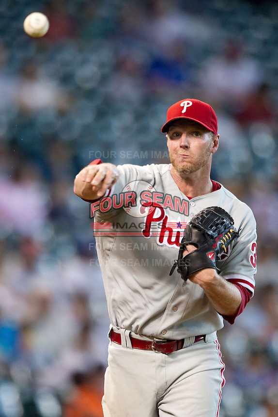 Philadelphia Phillies pitcher Roy Halladay #34 throws to first on an attempted pickoff during the Major League baseball game against the Houston Astros on September 16th, 2012 at Minute Maid Park in Houston, Texas. The Astros defeated the Phillies 7-6. (Andrew Woolley/Four Seam Images).