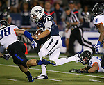 Nevada quarterback Cody Fajardo (17) runs against Boise State defenders Corey Bell (38) and Darian Thompson (4) during the first half of an NCAA college football game in Reno, Nev., on Saturday, Oct. 4, 2014. Boise State won 51-46. (AP Photo/Cathleen Allison)