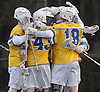Hofstra University teammates after a goal by Bryce Tolmie #9 broke a 6-6 tie with 1:37 remaining in the fourth quarter of an NCAA men's lacrosse game against Monmouth at Shuart Stadium in Hempstead, NY on Wednesday, March 14, 2018. Hofstra held on to win 7-6.