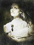 A monochromatic portrait of a woman in a vintage gown, pearl necklace and earrings, looking at the viewer in a curious manner.