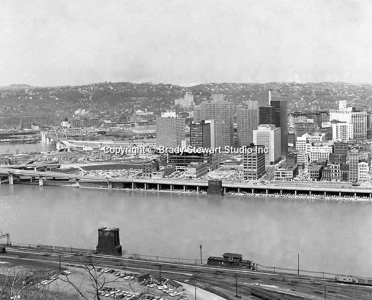Pittsburgh PA:  View of the city's skyline - 1962.  View includes Gateway Center and construction of the Pittsburgh Press Building.  View also includes the clearing of the Point and the Fort Duquesne Bridge and ramp construction.