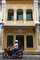 Romanee Street - One of the features of Phuket shophouses, or row houses as they are often called, is that the front verandahs form a sheltered walkway with intricate stucco designs gracing their facades. Walkways and interiors are covered with ceramic tiles with elaborate motifs.  Phuket has a long association with European trading nations such as  Portugal, Great Britain and France with an established population of ethnic Chinese who were the original traders. Phuket City has always been a meeting place of Thai and Malays and the overall result was a fascinating mixture of architecture.  Therefore the look and feel of old Phuket is unique in Thailand.