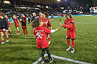 Portland, OR - Saturday, May 21, 2016: Portland Thorns FC defender Meg Morris (44) is presented with a rose after the match. The Portland Thorns FC defeated the Washington Spirit 4-1 during a regular season National Women's Soccer League (NWSL) match at Providence Park.