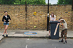 Children playing cricket in the street. Brunswick Street Walthamstow Village London E17 England 2009.
