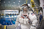 Houston, TX - January 28, 2009 -- Attired in a training version of his Extravehicular Mobility Unit (EMU) spacesuit, Japan Aerospace Exploration Agency (JAXA) astronaut Koichi Wakata, STS-119 mission specialist, is about to be submerged in the waters of the Neutral Buoyancy Laboratory (NBL) near NASA's Johnson Space Center. Divers (out of frame) are in the water to assist Wakata in his rehearsal, intended to help prepare him for work on the exterior of the International Space Station. Wakata is scheduled to join Expedition 18 as flight engineer after launching to the International Space Station with the STS-119 crew..Credit: Bill Stafford - NASA via CNP
