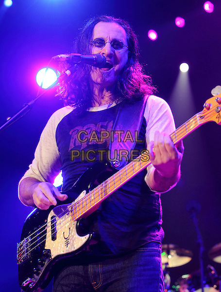 GEDDY LEE of RUSH.performs at the Giant Center in Hershey, PA, USA, April 8th, 2011..Half length music concert gig live on stage guitar playing vest sleeveless sunglasses microphone singing .CAP/RKE/EML.©EML/RockinExposures/Capital Pictures.