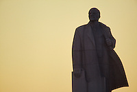 November 18, 1989. Sofia, Bulgaria. A Lenin statue watches as the sun sets over Communist rule. (Photo by Heimo Aga)