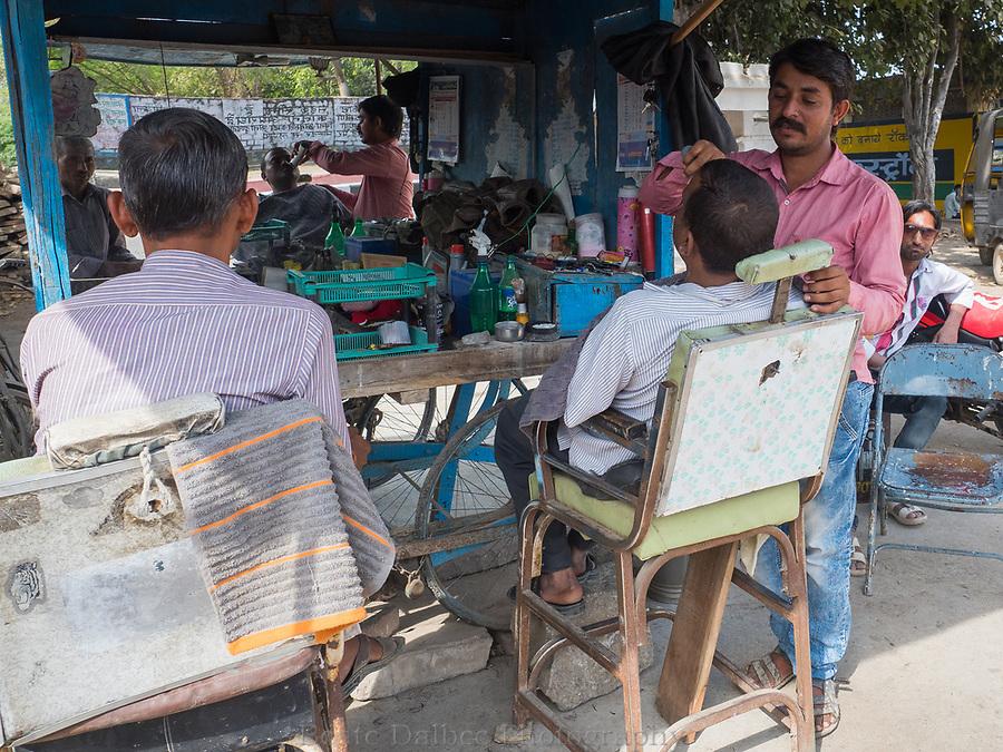 roadside barber, Rajasthan, India