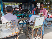 roadside barber, Rajasthan, India