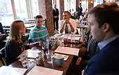 United States President Barack Obama has lunch with five young people at The Coupe Restaurant in the Columbia Heights section of Washington, DC, January 10, 2014 . The President wanted to hear directly from young people about their experiences spreading the word about the importance of signing up for quality, affordable health insurance and thank them for their efforts. <br /> Credit: Olivier Douliery / Pool via CNP