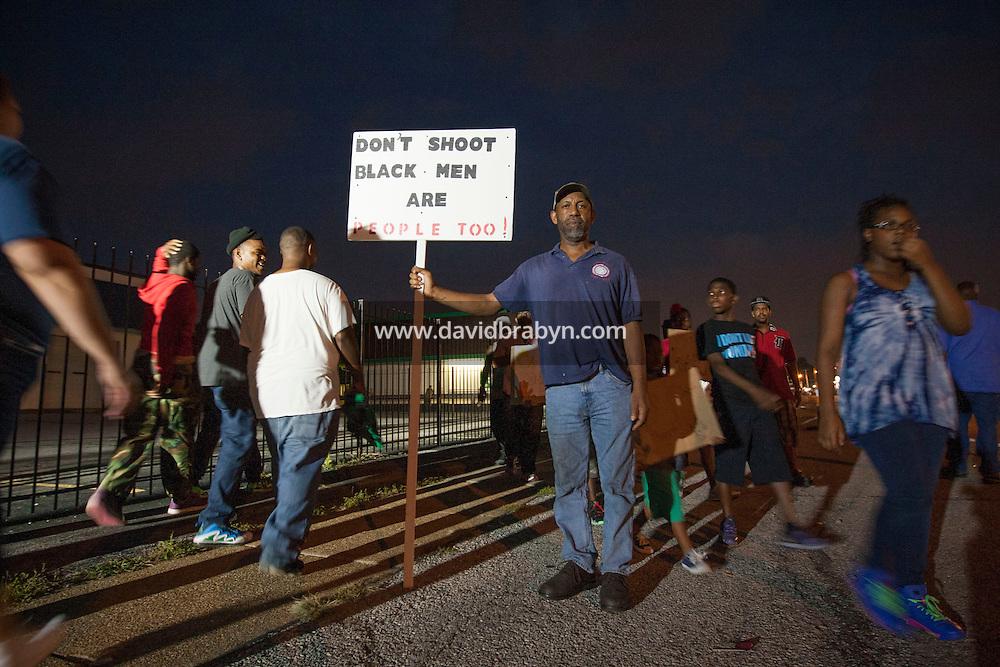 HSUL 20140818 United States, Ferguson, MO. John Morgan poses for the photographer on West Florissant Avenue in Ferguson, Missouri, on August 18, 2014. Photographer: David Brabyn