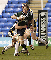 Reading, Berks, ENGLAND, 15.04.2006, Reading, Berks, ENGLAND, 15.04.2006, Exiles, Mike Catt, is tackled as he runs out of defence during the Guinness Premiership match, London Irish vs Leed Tykes, at the Madejski Stadium,  © Peter Spurrier/Intersport-images.com.