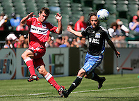 Chicago's Stephen King and San Jose's Ned Grabavoy chase down the ball. San Jose Earthquakes 0, Chicago Fire 1. McAfee Coliseum, Oakland, California. Saturday, April 12, 2008.