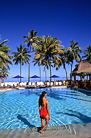 Colorful Woman in Red at Wonderful Pool Palm and Beach Shangra La Coral Coast in the Fiji Islands