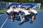 Skander Mansouri (center) of the Wake Forest Demon Deacons gets his team fired up prior to the start of the match against the North Carolina Tar Heels at the 2018 ACC Men's Tennis Championship at the Cary Tennis Center on April 29, 2018 in Cary, North Carolina.  The Demon Deacons defeated the Tar Heels 4-0.  (Brian Westerholt/Sports On Film)