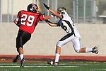 Palos Verdes, CA 11/10/10 - Evan Pantucci (Peninsula #16) and Matt Lopes(Palos Verdes # 29) in action during the junior varsity football game between Peninsula and Palos Verdes at Palos Verdes High School.