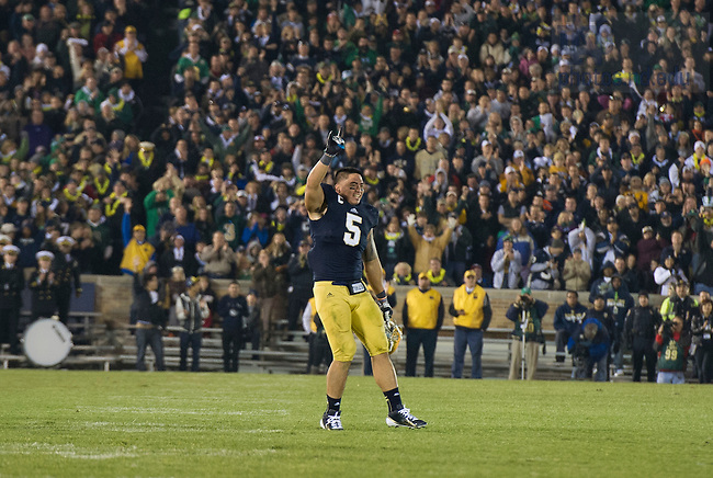 Nov. 17, 2012; Manti Te'o waves as he leaves the field in the fourth quarter against Wake Forest. Photo by Barbara Johnston/University of Notre Dame