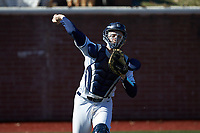 Wingate Bulldogs catcher Logan McNeely (18) makes a throw to first base against the Concord Mountain Lions at Ron Christopher Stadium on February 2, 2020 in Wingate, North Carolina. The Mountain Lions defeated the Bulldogs 12-11. (Brian Westerholt/Four Seam Images)