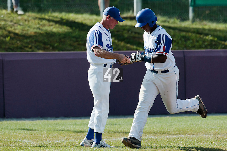 31 July 2010: Omar Williams of Team France is congratulated by John Haar as he runs the bases after his solo home run during the Greece 14-5 win over France, at the 2010 European Championship, in Heidenheim, Germany.