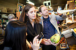 (L-R) Alexa Andrzejewski, 27, Soraya Darabi, 27, and Ted Grubb, 30, stop by Bi-Rite Market looking for fresh fruit and produce in the Mission District, in San Francisco, Ca., on Wednesday, May 25, 2011. They are three entreprenuers who developed the iPhone app, Foodspotting.