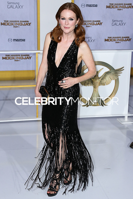 LOS ANGELES, CA, USA - NOVEMBER 17: Julianne Moore arrives at the Los Angeles Premiere Of Lionsgate's 'The Hunger Games: Mockingjay, Part 1' held at Nokia Theatre L.A. Live on November 17, 2014 in Los Angeles, California, United States. (Photo by Xavier Collin/Celebrity Monitor)