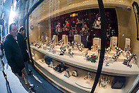 A display of luxury watches is seen in the window of a store in New York on Sunday, December 14, 2014. A recent study on conspicuous consumption reported that New Yorkers spend 597 percent more on watches than the rest of the country. (© Richard B. Levine)