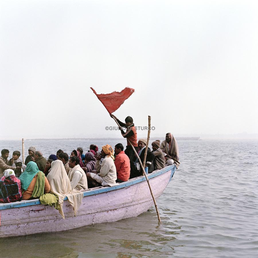 Hindu devotees bathe in the Ganges during the Kumbh Mela, India 2013.