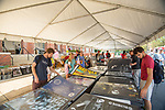 Students can get posters for their walls at the tent sale at Weir Hall at Galtney-Lott plaza.  Photo by Kevin Bain/Ole Miss Communications