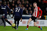 Oliver McBurnie of Sheffield United flicks the ball through the legs of Angelo Ogbonna of West Ham United  during the Premier League match at Bramall Lane, Sheffield. Picture date: 10th January 2020. Picture credit should read: James Wilson/Sportimage