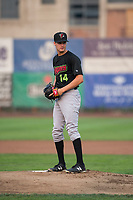 Great Falls Voyagers starting pitcher Jason Bilous (14) gets ready to deliver a pitch during a Pioneer League against the Ogden Raptors at Lindquist Field on August 23, 2018 in Ogden, Utah. The Ogden Raptors defeated the Great Falls Voyagers by a score of 8-7. (Zachary Lucy/Four Seam Images)