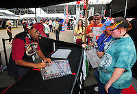 Mar. 9, 2012; Gainesville, FL, USA; NHRA top fuel dragster driver Khalid Albalooshi signs autographs during qualifying for the Gatornationals at Auto Plus Raceway at Gainesville. Mandatory Credit: Mark J. Rebilas-