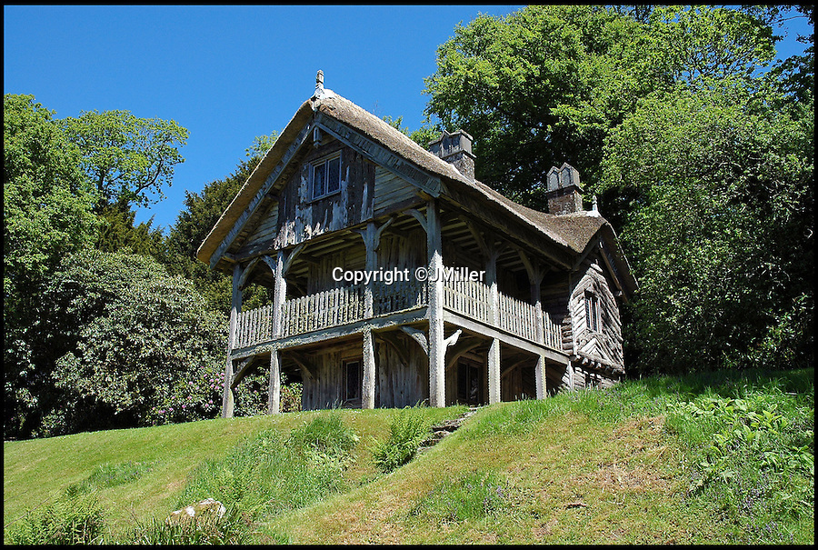 BNPS.co.uk (01202 558833)<br /> Pic: LandmarkTrust/BNPS<br /> <br /> A Swiss mountain cottage...In Devon..<br /> <br /> Fully booked...Holidays less ordinary spark a booking frenzy in Brits.<br /> <br /> A charity which rents out historic buildings around Britain is celebrating a boom in business that has seen some of its properties booked out years in advance.<br /> <br /> The Landmark Trust has transformed almost 200 of the country's quirkiest buildings - from medieval castles to Tudor towers and even a former pig sty - into unique holiday homes.<br /> <br /> And they have become so popular with Brits looking for unusual places to escape to that some buildings are fully booked until 2016.<br /> <br /> Top of the most popular properties are Luttrell's Tower, a Georgian folly near Southampton, Hants, and Astley Castle, a Saxon stronghold dating back to the 12th century in Nuneaton, Warks.<br /> <br /> Other favourites include a Victorian pigsty near Whitby, North Yorks, which was built in the style of a Greek temple, and the London townhouse of 20th century poet John Betjeman.<br /> <br /> The buildings have become such a hit among holidaymakers that they are willing to fork out thousands of pounds to stay in them.<br /> <br /> While prices start at 10 pounds a night for cosy cottages in winter, a seven-night stay at the most popular properties in the height of summer can cost up to 3,000 pounds.<br /> <br /> But the fees are then ploughed back into the upkeep and restoration of the properties.
